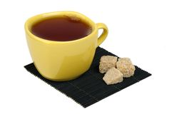 Tea and sugar cane on the mat Royalty Free Stock Image