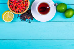 Tea sugar, lemon, lime and rose hips Royalty Free Stock Photos
