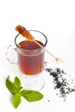 Tea with sugar on a stick Stock Image
