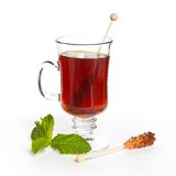 Tea with sugar on a stick Royalty Free Stock Photo