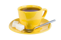 Tea with sugar in yellow cup Stock Photos