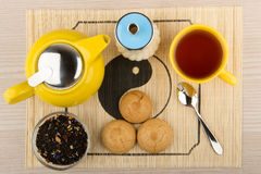 Tea with sugar, yellow glass kettle and biscuits Royalty Free Stock Photos