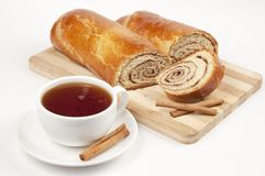 Tea and sweet rolls with cinnamon filling Royalty Free Stock Photos
