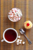Tea and sweetness Stock Photos