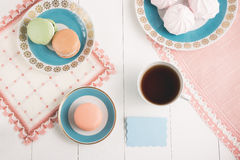 Tea with sweets and card on white background. Selective focus, top view, macro, toned image, film effect. Tea with sweets and card on white background. Selective Stock Photo