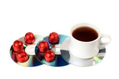 Tea, sweets, CDs. Stock Image