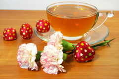 Tea sweets and flowers Royalty Free Stock Photo