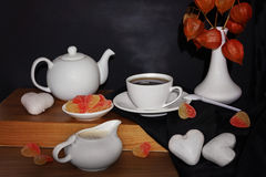 Tea and sweets in form of hearts on the table. Stock Image