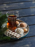 Tea and sweets - homemade chocolate truffles and biscuits Stock Image