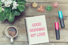 Tea with sweets and an inscription in notebook: Good morning my love. Top view. Effect film Stock Photo