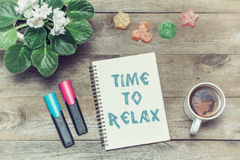 Tea with sweets and an inscription in notebook: Time to relax Stock Images