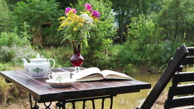 Tea table with a book Stock Photography