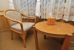 Tea table and chair in hotel room Royalty Free Stock Photo