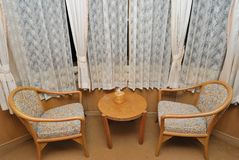 Tea table and chairs for resting in hotel room Royalty Free Stock Photos
