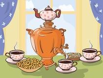 Tea table with samovar in Slavic style Stock Photo