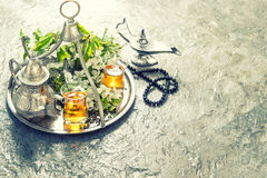 Tea table setting with arabian lantern and rosary. Islamic holid Royalty Free Stock Photography