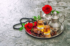 Tea table setting red rose flowers Islamic holidays decoration. Tea table setting with red rose flowers. Islamic holidays decoration. Ramadan kareem. Vibrant Stock Photos