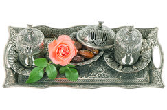 Tea table setting withdates, mint leaves and rose flower Stock Images