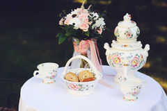 Tea table for two placed outdoors Stock Images