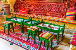 The tea tables. SOUSSE, TUNISIA - SEPTEMBER 1, 2015: Every arabic restaurant is also a tea house, so it offers large tables for eat, and tiny ones for drinking Royalty Free Stock Photo