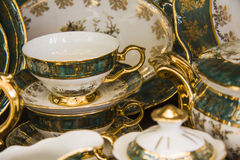 Tea tableware set of green color Stock Image