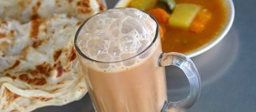 Tea Tarik and Roti Canai. Popular breakfast combination for asian people to enjoy during the morning breakfast Royalty Free Stock Photo