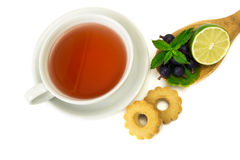 Tea for tea. Cup of tea, cookies and limete served and  on white background Stock Photos
