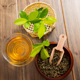 Tea and tea leaves. On wooden table Royalty Free Stock Photography