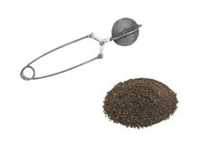 Tea and tea strainer. Black tea and tea strainer Royalty Free Stock Images