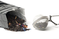 Tea and tea strainer Stock Images