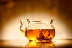 Tea in teapot Stock Photos