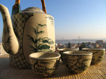 Tea on terrace. Tea pot and cups over a city view Royalty Free Stock Photos