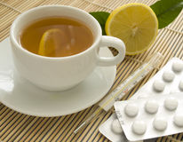 Tea, thermometer and pills Royalty Free Stock Photo