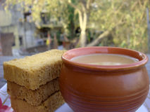 Tea and three rusks on focus. Placed outside Stock Photos