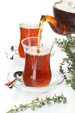 Tea thymus pour into glass cup Stock Image