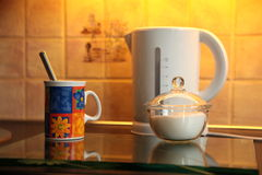 Tea time. View of a kettle, cup and sugar bowl Stock Photos