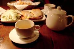 Tea time. Drink a cup of tea after work Stock Photos