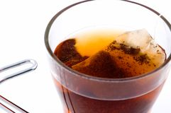 Tea time. A cup tea with the bag Royalty Free Stock Photo