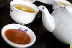 Tea time. A combination of tea, teapot with chili source when going for Dim Sum Stock Photos