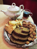 Tea time. Tea and selection of cakes and cookies Royalty Free Stock Image