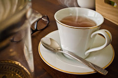 Tea Time. Setting of a teacup on a table with tea mug and props Stock Images