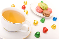 Tea Time. Cup of tea with some colorful chocolates and macaron Royalty Free Stock Photos