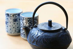 Tea Time. A teapot with two teacups Royalty Free Stock Images