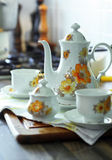 Tea time. With retro teapot and cups in the kitchen Royalty Free Stock Photography