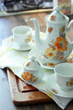 Tea time. With retro teapot and cups in the kitchen Stock Photography