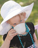 Tea time. A beautiful little girl all dressed up for tea time Royalty Free Stock Photo