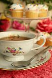 Tea time. A nice cup of tea with little cake Royalty Free Stock Photos