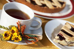 Tea time. A  cup of tea with a slice of cake  - tea time or breakfast concept Stock Image