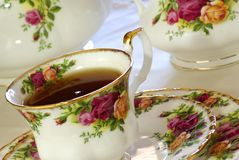 Tea Time. Porcelain china cup of tea. Close up Stock Photos