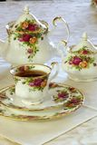 Tea Time. Porcelain china cup of tea with teapot and sugar bowl Royalty Free Stock Photos